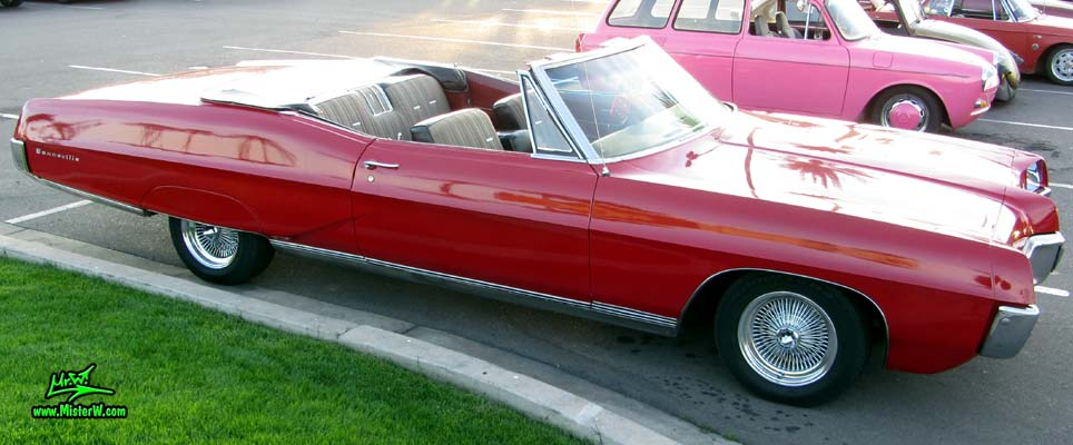 Photo of a red 1967 Pontiac Bonneville Convertible at the Scottsdale Pavilions Classic Car Show in Arizona. 1967 Pontiac Bonneville Convertible With Chrome Spoke Wheels