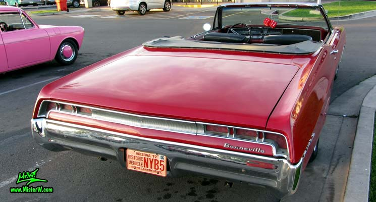 Photo of a red 1967 Pontiac Bonneville Convertible at the Scottsdale Pavilions Classic Car Show in Arizona. 1967 Pontiac Bonneville Convertible Rear Tail Lights