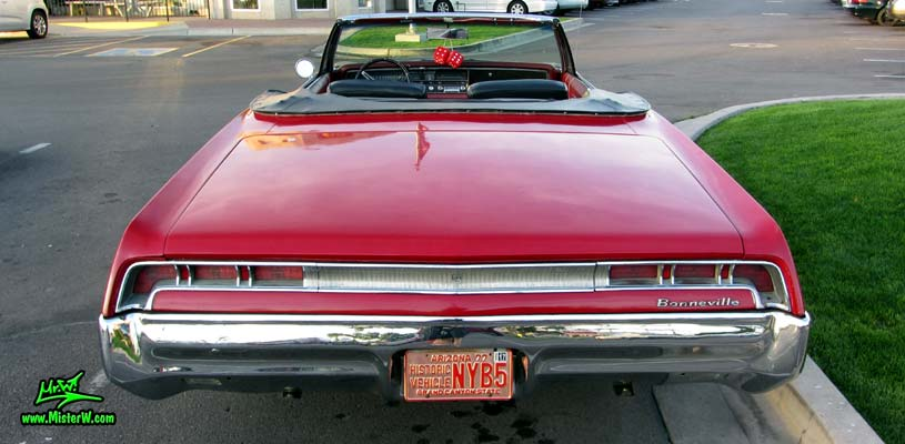 Photo of a red 1967 Pontiac Bonneville Convertible at the Scottsdale Pavilions Classic Car Show in Arizona. 1967 Pontiac Bonneville Convertible Rearview