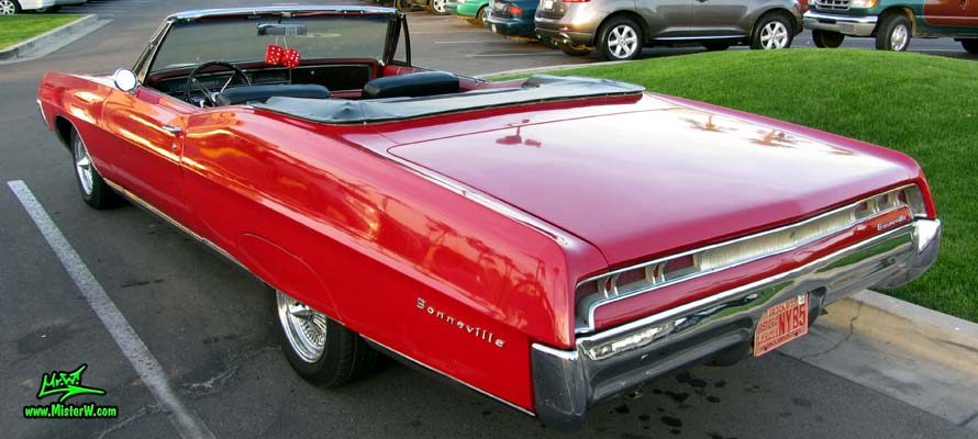Photo of a red 1967 Pontiac Bonneville Convertible at the Scottsdale Pavilions Classic Car Show in Arizona. Topless 1967 Pontiac Bonneville Convertible