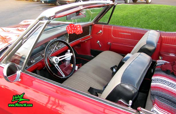 Photo of a red 1967 Pontiac Bonneville Convertible at the Scottsdale Pavilions Classic Car Show in Arizona. 1967 Pontiac Bonneville Front Seats & Dash Board