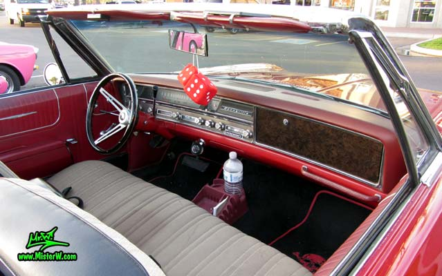 Photo of a red 1967 Pontiac Bonneville Convertible at the Scottsdale Pavilions Classic Car Show in Arizona. 1967 Pontiac Bonneville Convertible Dashboard