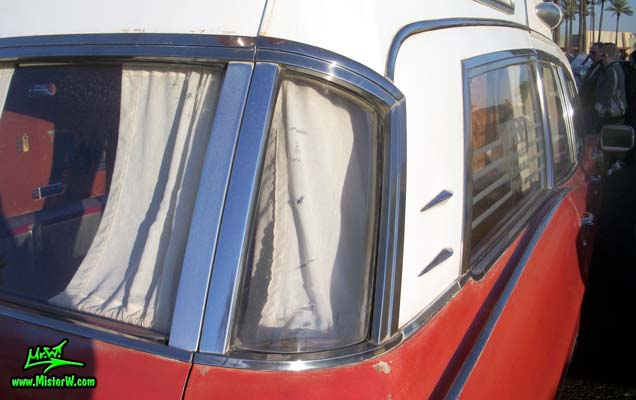 Photo of a red & white 1968 Pontiac Bonneville Ambulance at the Scottsdale Pavilions Classic Car Show in Arizona. Curved Rear Window of a 68 Pontiac Bonneville Ambulance