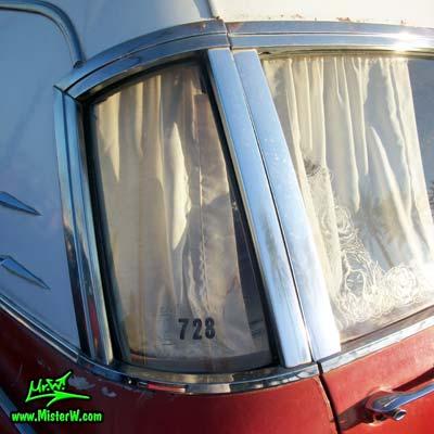 Photo of a red & white 1968 Pontiac Bonneville Ambulance at the Scottsdale Pavilions Classic Car Show in Arizona. Curved Back Window of a 68 Pontiac Bonneville Ambulance