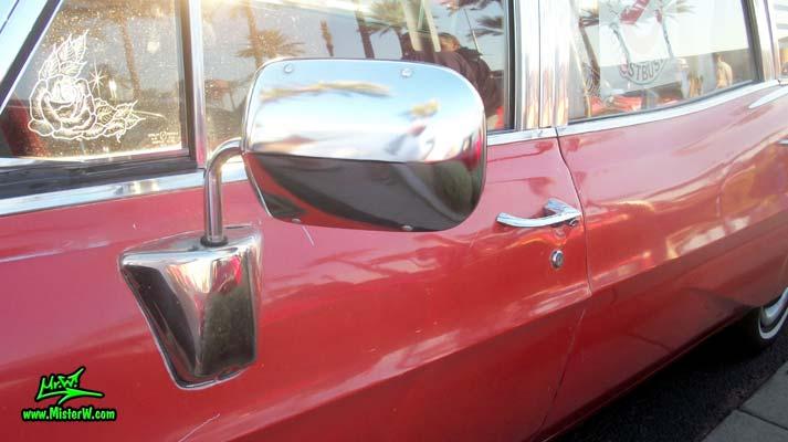 Photo of a red & white 1968 Pontiac Bonneville Ambulance at the Scottsdale Pavilions Classic Car Show in Arizona. Driver Side Mirror of a 68 Pontiac Bonneville Ambulance