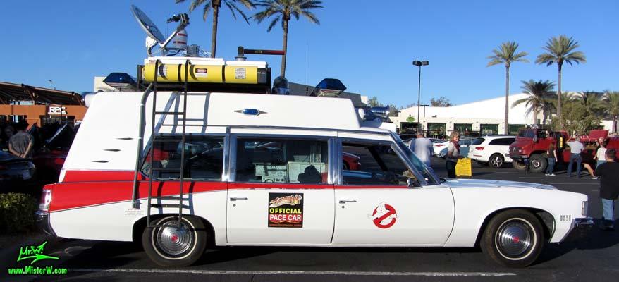 Photo of a red & white Pontiac Bonneville Ambulance at the Scottsdale Pavilions Classic Car Show in Arizona. Sideview of a 72 Pontiac Pontiac Bonneville Ambulance