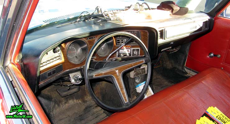 Photo of a red & white Pontiac Bonneville Ambulance at the Scottsdale Pavilions Classic Car Show in Arizona. Dashboard & Speedometer of a 72 Pontiac Pontiac Bonneville Ambulance