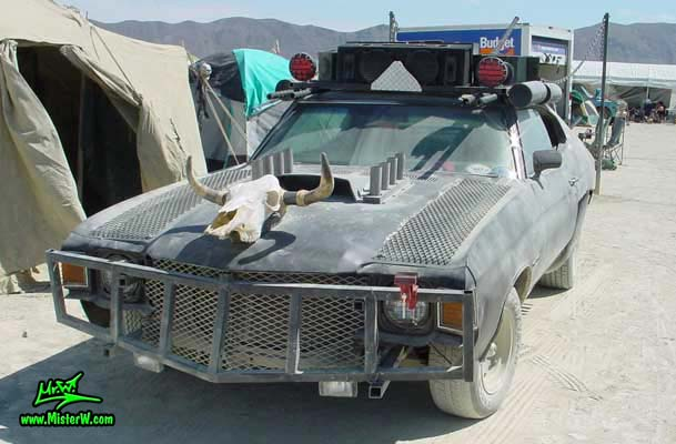 Photo of a Post Apocalyptic Wasteland, Road Warrior, Death Race, Zombie Attack, Assault Vehicle, Mad Max Interceptor like, Post Apocalyptic Mad Max Wasteland Road Warrior with Skull Hood Ornament
