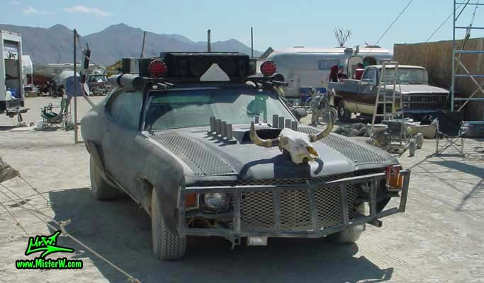 Photo of a Post Apocalyptic Wasteland, Road Warrior, Death Race, Zombie Attack, Assault Vehicle, Mad Max Interceptor like, Post Apocalyptic Mad Max Wasteland Road Warrior Frontview
