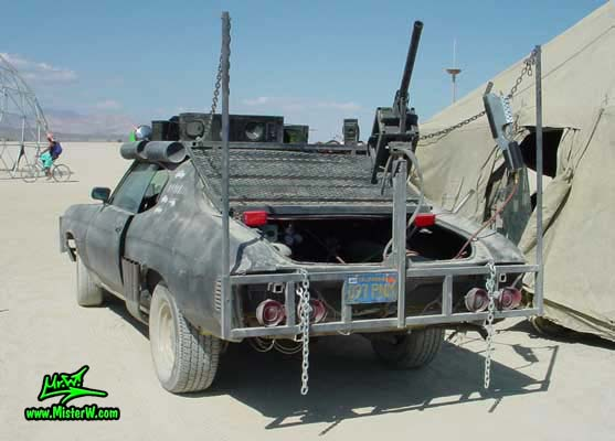 Photo of a Post Apocalyptic Wasteland, Road Warrior, Death Race, Zombie Attack, Assault Vehicle, Mad Max Interceptor like, Post Apocalyptic Mad Max Wasteland Road Warrior Rearview