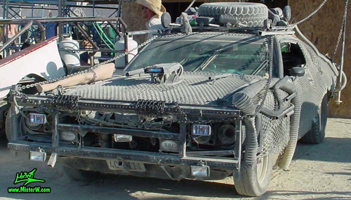 Photo of Vector a Post Apocalyptic Wasteland, Road Warrior, Death Race, Zombie Attack, Assault Vehicle, Mad Max Interceptor like, Post Apocalyptic Mad Max Wasteland Road Warrior Car Vector Frontview