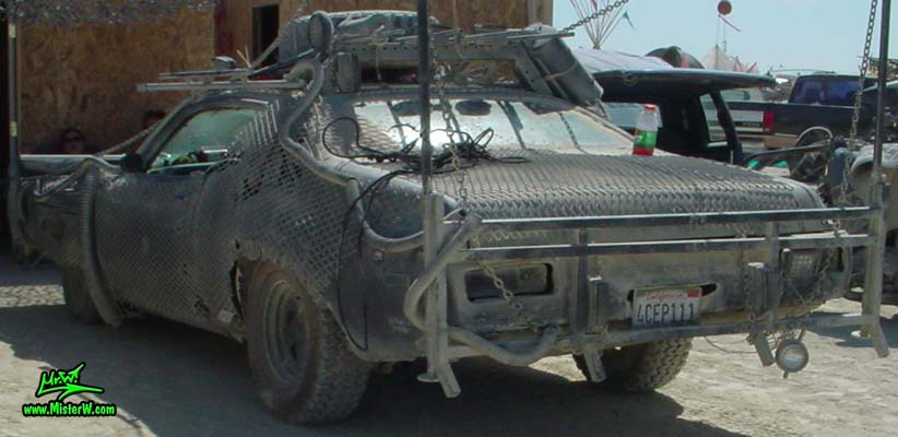 Photo of Vector a Post Apocalyptic Wasteland, Road Warrior, Death Race, Zombie Attack, Assault Vehicle, Mad Max Interceptor like, Post Apocalyptic Wasteland Road Warrior Car Vector Rearview
