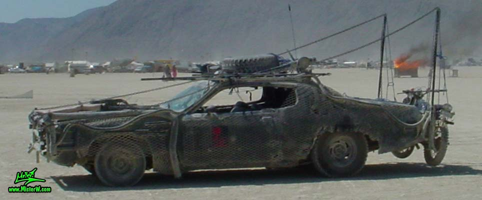 Photo of Vector a Post Apocalyptic Wasteland, Road Warrior, Death Race, Zombie Attack, Assault Vehicle, Mad Max Interceptor like, Post Apocalyptic Mad Max Road Warrior Car Vector Sideview