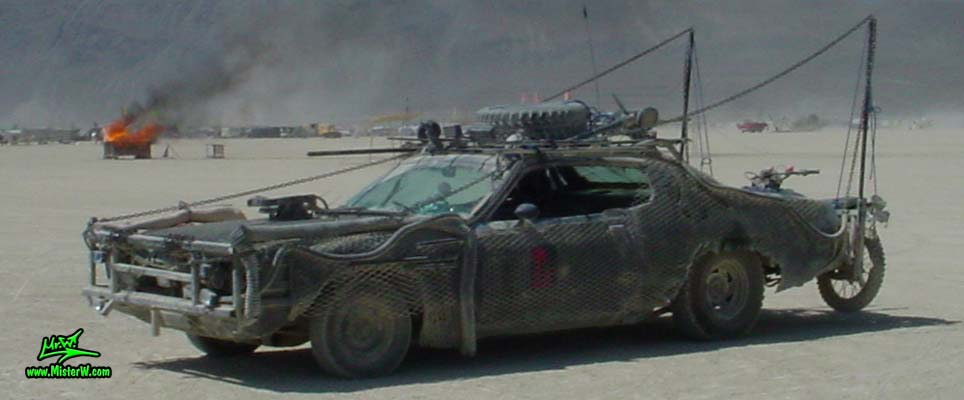 Photo of Vector a Post Apocalyptic Wasteland, Road Warrior, Death Race, Zombie Attack, Assault Vehicle, Mad Max Interceptor like, Mad Maxed Post Apocalyptic Wasteland Road Warrior