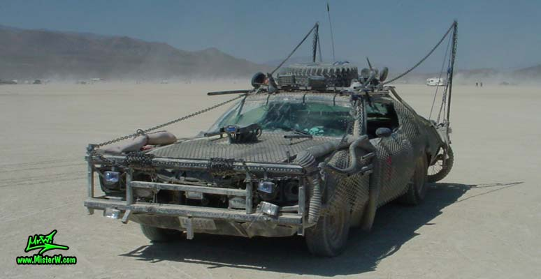 Photo of Vector a Post Apocalyptic Wasteland, Road Warrior, Death Race, Zombie Attack, Assault Vehicle, Mad Max Interceptor like, Post Apocalyptic Road Warrior with front bumper brush guard made from steel bars taken from New York City no parking signs.