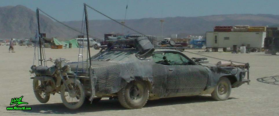Photo of Vector a Post Apocalyptic Wasteland, Road Warrior, Death Race, Zombie Attack, Assault Vehicle, Mad Max Interceptor like, Dusty Post Apocalyptic Mad Max Wasteland Road Warrior Car Vector