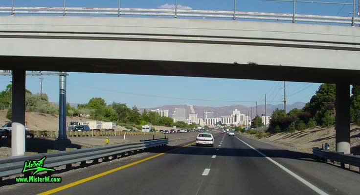Photo of downtown Reno, Nevada taken from the freeway going east on Interstate 80 in summer 2002 Interstate 80 headed for Downtown Reno