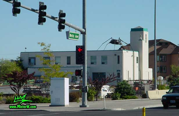 Photo of a Volkswagen Bug Spider Sculpture on top of a Building, taken from Wells Avenue & 6th Street, summer 2002 VW Beetle Spider in Reno