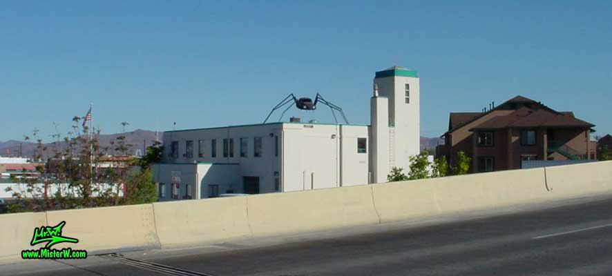 Photo of a Volkswagen Bug Spider Sculpture on top of a Building, taken from the Wells Avenue overpass, summer 2002 Volkswagen Beetle Spider Sculpture in Reno