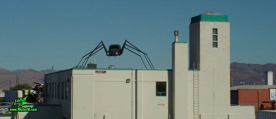 Photo of a Volkswagen Bug Spider Sculpture on top of a Building, taken from the Wells Avenue overpass, summer 2002 VW Beetle Spider Sculpture in Reno