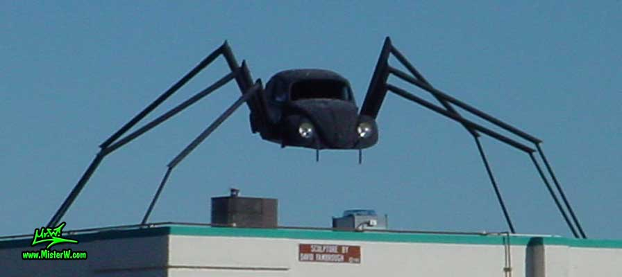 Photo of a Volkswagen Bug Spider Sculpture on top of a Building, taken from the Wells Avenue overpass, summer 2002 Volkswagen Bug Spider Sculpture in Reno