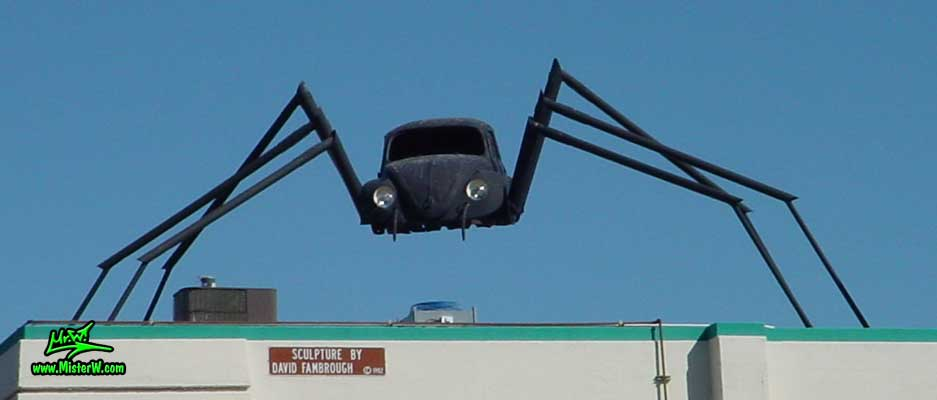 Photo of a Volkswagen Bug Spider Sculpture on top of a Building, taken from the Wells Avenue overpass, summer 2002 Volkswagen Bug Spider Sculpture by David Fambrough in Reno