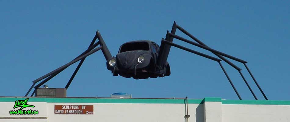 Photo of a Volkswagen Bug Spider Sculpture on top of a Building, taken from the Wells Avenue overpass, summer 2002 VW Bug Spider Sculpture by David Fambrough in Reno