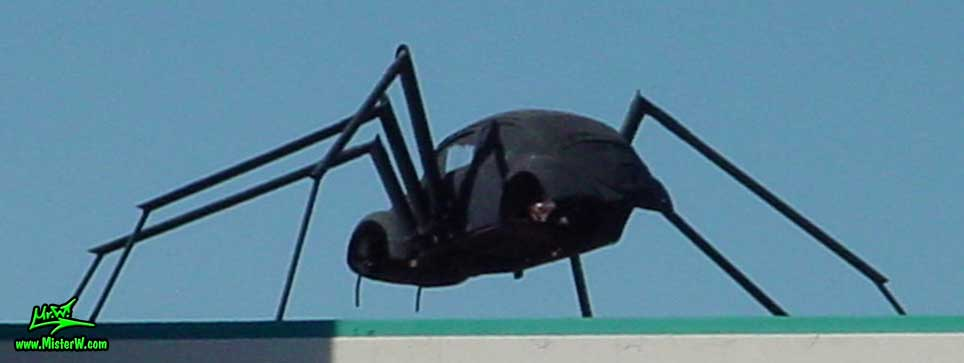 Photo of a Volkswagen Bug Spider Sculpture on top of a Building, taken from Morrill Avenue, summer 2002 Volkswagen Beetle Spider Sculpture by David Fambrough in Reno