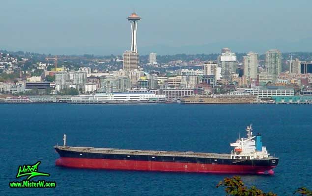 Photo of a oil tanker ship in front of the Space Needle in Seattle taken from the Viewpoint on SW Admiral Way in summer 2002  Skyline of Seattle with Oil Tanker Ship