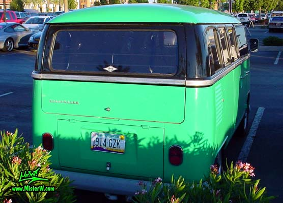 Photo of a green & black Volkswagen Type 2 Transporter Van at the Scottsdale Pavilions Classic Car Show in Arizona. Rear view of a Volkswagen Bus Transporter Van