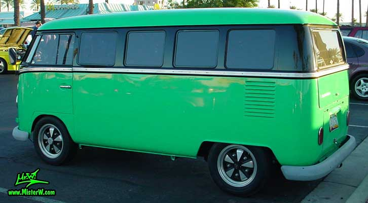 Photo of a green & black Volkswagen Type 2 Transporter Van at the Scottsdale Pavilions Classic Car Show in Arizona. Side view of a VW Type 2 Bus