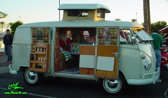 Photo of a white Volkswagen Type 2 Transporter Van at the Scottsdale Pavilions Classic Car Show in Arizona. Side view of a VW Camper Van