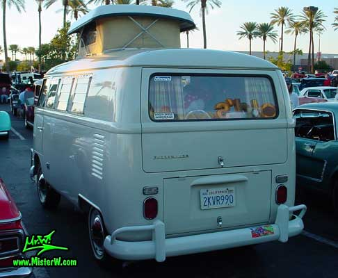 Photo of a white Volkswagen Type 2 Transporter Van at the Scottsdale Pavilions Classic Car Show in Arizona. Rear view of a Volkswagen Camper Van