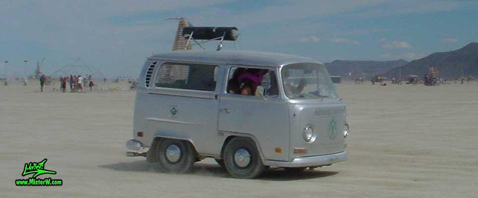 Photo of a shortened silver Volkswagen Type 2 Transporter Van at the Burning Man Festival in Black Rock City, Nevada. Shortened VW Bus