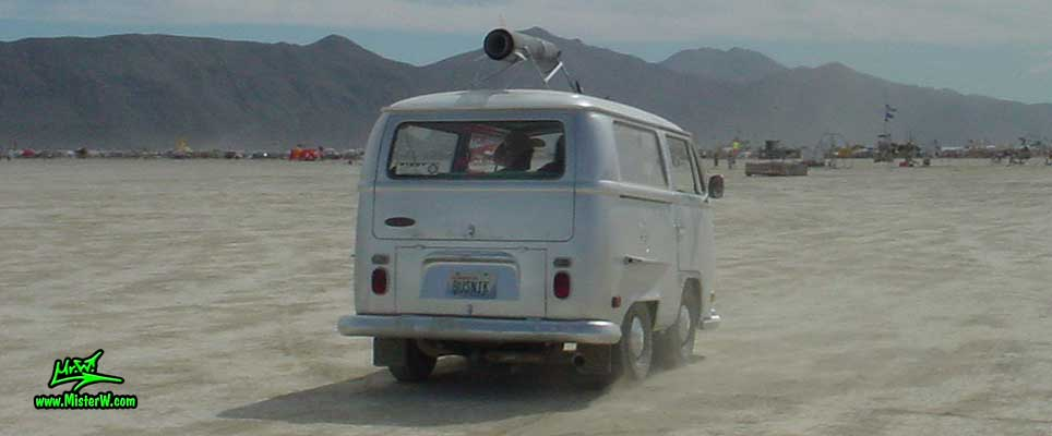 Photo of a shortened silver Volkswagen Type 2 Transporter Van at the Burning Man Festival in Black Rock City, Nevada. Short Volkswagen Bus
