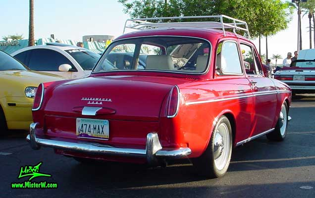 Photo of a red Volkswagen Type 3 Notchback Coupe at the Scottsdale Pavilions Classic Car Show in Arizona. VW Coupe