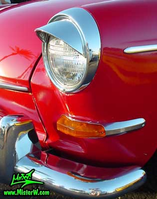 Photo of a red Volkswagen Type 3 Notchback Coupe at the Scottsdale Pavilions Classic Car Show in Arizona. Head Light of a VW Typ 3 Stufenheck Limousine
