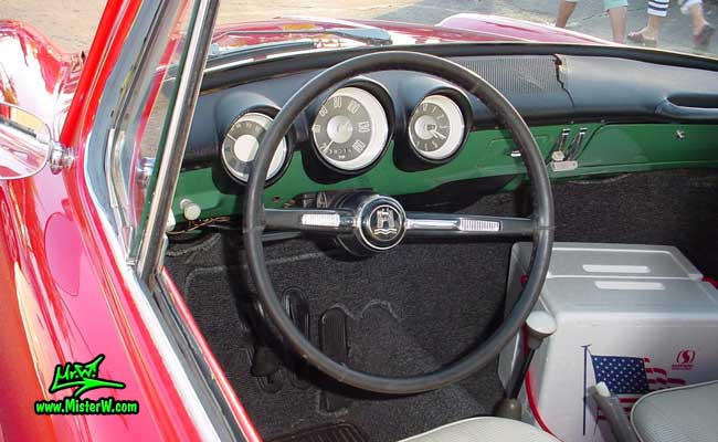 Photo of a red Volkswagen Type 3 Notchback Coupe at the Scottsdale Pavilions Classic Car Show in Arizona. Dashboard of a VW Notchback