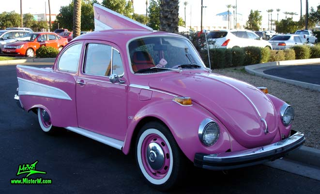 Photo of a customized pink Volkswagen Kaefer / Bug / Beetle modified with 1957 Chevrolet Fins at the Scottsdale Pavilions Classic Car Show in Arizona. Pink 57 VW Chevy Beetle