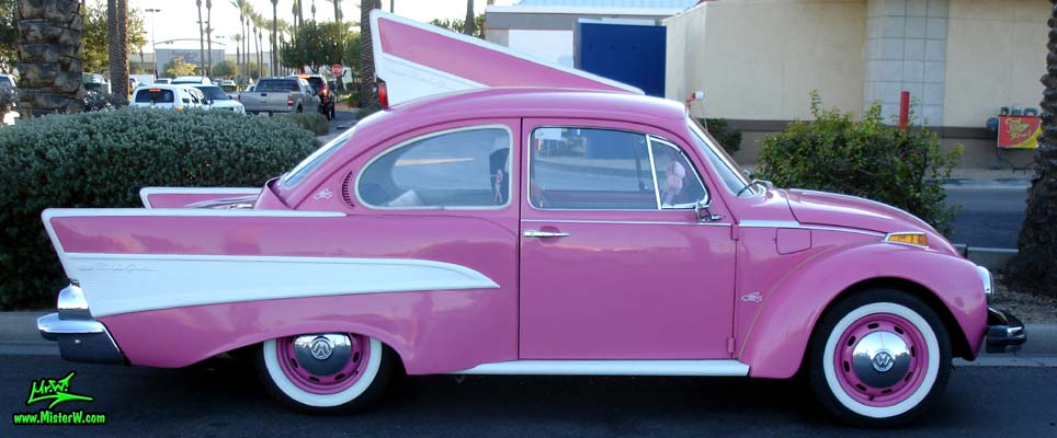 Photo of a customized pink Volkswagen Kaefer / Bug / Beetle modified with 1957 Chevrolet Fins at the Scottsdale Pavilions Classic Car Show in Arizona. Custom 57 VW Chevy Bug Sideview
